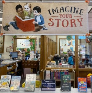 book display and reading program banner
